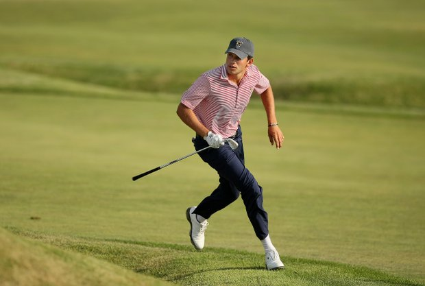 Cory Whitsett runs around the berm to see where his shot landed at No. 17 during Saturday's singal matches of the 2013 Walker Cup at National Golf Links of America in Southampton, N.Y.