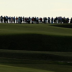 Spectators watch the action at No. 18 green during Saturday's singal matches of the 2013 Walker Cup at National Golf Links of America in Southampton, N.Y.