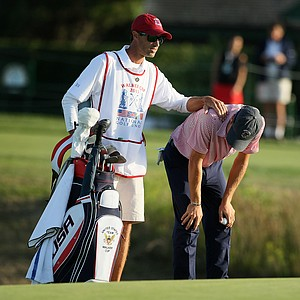 Justin Thomas with his caddie Jesse Muller reacts to his ball just missing the hole at No. 18 during Saturday's singals matches of the 2013 Walker Cup at National Golf Links of America in Southampton, N.Y.