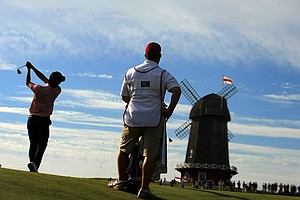 Michael Kim hits his shot at No. 16 during the Saturday's singal matches of the 2013 Walker Cup at National Golf Links of America in Southampton, N.Y.