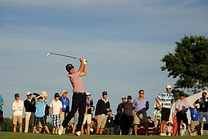 Justin Thomas hits his second shot at No. 18 during Saturday's singal matches of the 2013 Walker Cup at National Golf Links of America in Southampton, N.Y.