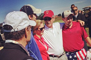 Former president George W. Bush poses with spectators on Saturday of the 2013 Walker Cup at National Golf Links of America in Southampton, N.Y.
