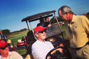 Former president George W. Bush mingles at No. 11 on Saturday of the 2013 Walker Cup at National Golf Links of America in Southampton, N.Y.