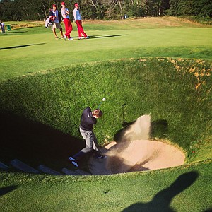 Matthew Fitzpatrick hits a bunker shot on Saturday of the 2013 Walker Cup at National Golf Links of America in Southampton, N.Y.