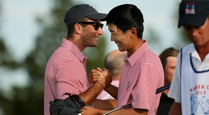 Max Homa and Michael Kim celebrate after both won their singles matches Saturday during the 2013 Walker Cup at National Golf Links in Southampton, N.Y.