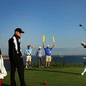 USA's Michael Kim tees off during Sunday foursomes of the 2013 Walker Cup at National Golf Links of America in Southampton, N.Y.