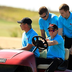 GB&I captain Nigel Edwards leaves with Callum Shinkwin, Jordan Smith and Max Orrin after Orrin lost his match during Sunday foursomes of the 2013 Walker Cup at National Golf Links of America in Southampton, N.Y.