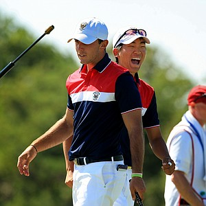 Max Homa and Michael Kim celebrate winning during Sunday foursomes of the 2013 Walker Cup at National Golf Links of America in Southampton, N.Y.