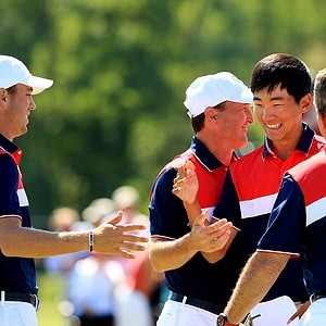 Team USA celebrates during Sunday foursomes of the 2013 Walker Cup at National Golf Links of America in Southampton, N.Y.