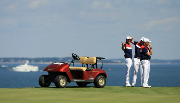USA captain Jim Holtgrieve with Max Homa and Cory Whitsett at No. 18 during Sunday foursomes of the 2013 Walker Cup at National Golf Links of America in Southampton, N.Y.