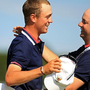 USA's Justin Thomas gets a hug from the team manager, Robbie Zalzneck after winning his match 6 and 4 during Sunday singles of the 2013 Walker Cup at National Golf Links of America in Southampton, N.Y.
