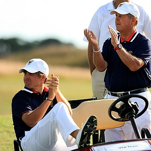Team USA's Bobby Wyatt, captain Jim Holtgrieve and Michael Weaver cheer on teammates during Sunday singles of the 2013 Walker Cup at National Golf Links of America in Southampton, N.Y.