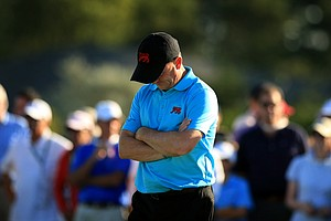 GB&I captain Nigel Edwards looks down after another one of his players fell to the USA during Sunday singles of the 2013 Walker Cup at National Golf Links of America in Southampton, N.Y.