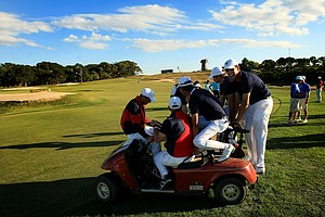 Victorious Team USA ride around on a cart greeting players as matches end during Sunday singles of the 2013 Walker Cup at National Golf Links of America in Southampton, N.Y.