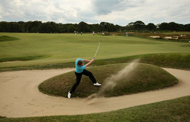 GB&I's Max Orrin hits out of a bunker at No. 12 in his loss to Justin Thomas during Sunday singals of the 2013 Walker Cup at National Golf Links of America in Southampton, N.Y.