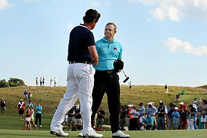 Team USA's Nathan Smith shakes hands with GB&I's Nathan Kimsey after Smith clinced the final point needed to win The Walker Cup during Sunday singals of the 2013 Walker Cup at National Golf Links of America in Southampton, N.Y.