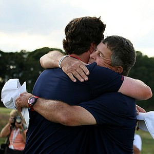 USA captain, Jim Holtgrieve hugs Nathan Smith after he won his singals match at the 2013 Walker Cup at National Golf Links of America in Southampton, N.Y.