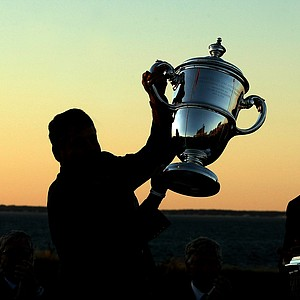 Team USA captain Jim Holtgrieve is silhoutted as he hoists the The Walker Cup trophy during closing ceremonies at the 2013 Walker Cup at National Golf Links of America in Southampton, N.Y.(Photo by Tracy Wilcox/GOLFWEEK)