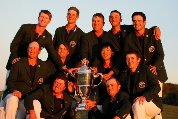 Team USA poses with the trophy after defeating GB&I at the 2013 Walker Cup at National Golf Links of America in Southampton, N.Y.