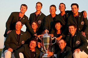 Team USA poses with the Walker Cup after defeating GB&I 17-9 during the 2013 Walker Cup at National Golf Links of America in Southampton, N.Y.