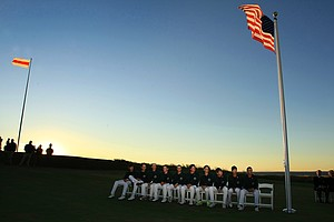 Team USA sits on the lawn waiting for the trophy after defeating GB&I 17-9 during the 2013 Walker Cup at National Golf Links of America in Southampton, N.Y.