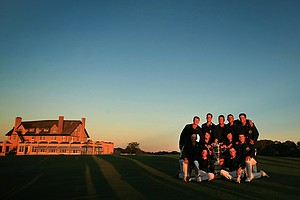 Team USA poses with the Walker Cup trophy at National Golf Links of America in Southampton, N.Y.