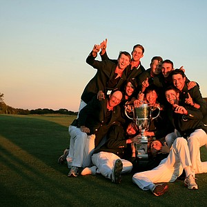 Team USA has a little fun with the trophy after defeating GB&I 17-9 at the 2013 Walker Cup. In 2021, the Match will be played at Seminole GC in Juno Beach, Fla.