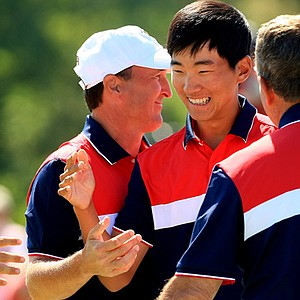 Michael Kim and his U.S. teammates celebrate after Kim and partner Max Homa came back to win 1 up in morning foursomes action at the Walker Cup.
