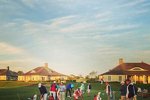 Teams practice on the Sebonack Golf Club driving range prior to Sunday foursomes of the 2013 Walker Cup at National Golf Links of America in Southampton, N.Y.