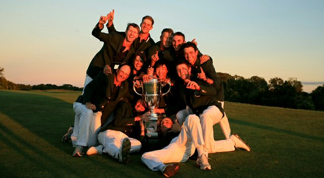 Team USA has a little fun with the trophy after defeating GB&I 17-9 at the 2013 Walker Cup in Southampton, N.Y.