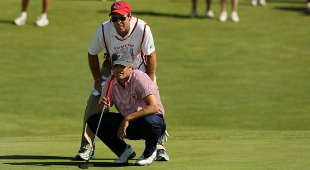 Bobby Wyatt with his caddie Kurt Sohn on Saturday during the singal matches of the 2013 Walker Cup at National Golf Links of America in Southampton, N.Y.