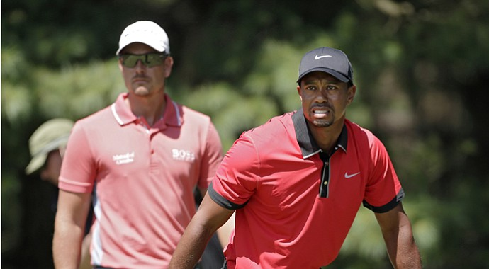 Tiger Woods and Henrik Stenson at the 2013 WGC-Bridgestone Championship.