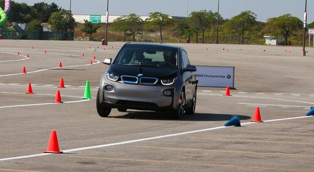 Gary Woodland hugs the corners in the new BMW i3 on the course at Six Flags Great America on Tuesday.