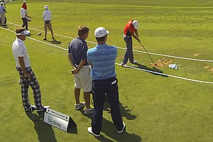 On Tuesday, Rory McIlroy practices hitting his Nike VR_S Covert fairway woods as Ian Poulter, McIlroy's caddie J.P. Fitzgerald and Justin Rose watch.