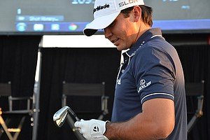 Jason Day tries a new TaylorMade SpeedBlade 3-iron at an event the company hosted on the practice range Monday evening.