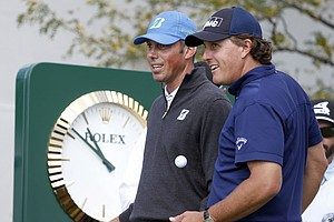 Matt Kuchar (left) and Phil Mickelson during the second round of the BMW Championship, the third event of the 2013 FedEx Cup, from Conway Farms near Chicago.