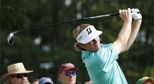 Brandt Snedeker hits a tee shot during the first round of the BMW Championship, the third event in the PGA Tour's 2013 FedEx Cup playoffs.