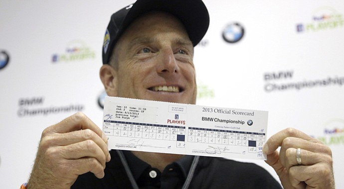 Jim Furyk holds his 59 scorecard from Friday's second round at the BMW Championship, the third event of the 2013 FedEx Cup playoffs on PGA Tour, at Conway Farms near Chicago.