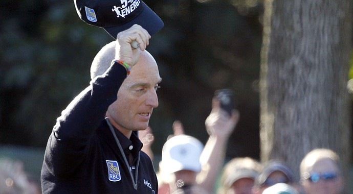 Jim Furyk reacts to the gallery after finishing with 59 during Friday's second round at the BMW Championship, the third event of the PGA Tour's 2013 FedEx Cup playoffs, at Conway Farms near Chicago.
