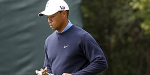 Two-stroke penalty adds to Tiger's BMW tally