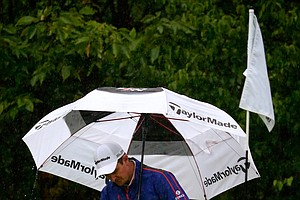 Justin Rose during Sunday's rainy final round of the 2013 BMW Championship, the third event of the PGA Tour's FedEx Cup playoffs, at Conway Farms near Chicago.