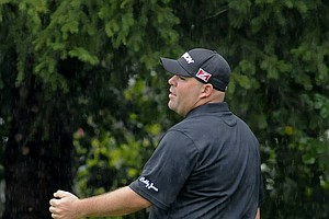 Kevin Stadler during Sunday's rainy final round of the 2013 BMW Championship, the third event of the PGA Tour's FedEx Cup playoffs, at Conway Farms near Chicago.