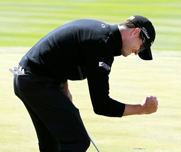 Zach Johnson reacts to a birdie putt at No. 16 during his win Monday at the BMW Championship, the third event of the 2013 FedEx Cup playoffs on PGA Tour, at Conway Farms near Chicago.