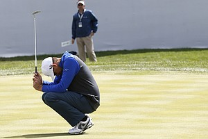 Nick Watney misses a birdie putt on the 18th hole during the final round of the BMW Championship, the third event of the 2013 FedEx Cup playoffs on PGA Tour, at Conway Farms near Chicago.