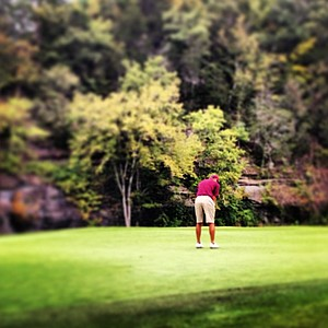 Texas A&M's Ben Crancer standing over his putt on No. 9 (his 18th hole) to shoot a competitive course record of 8-under 63 at The Golf Club of Tennessee during the second round of the Collegiate Challenge Cup.