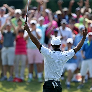 Tiger Woods celebrates a birdie at No. 3 during Friday's second round at the Tour Championship, the final event of the 2013 FedEx Cup playoffs on PGA Tour, at East Lake in Atlanta.