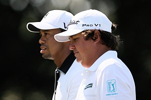 Tiger Woods and Jason Dufner during Friday's second round at the Tour Championship, the final event of the 2013 FedEx Cup playoffs on PGA Tour, at East Lake in Atlanta.