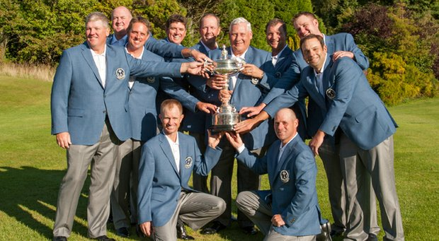 The U.S. team celebrates retaining the PGA Cup after a 13-13 tie in England.