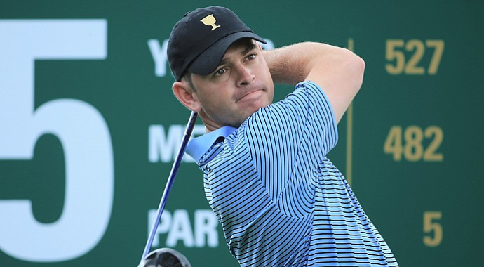 Louis Oosthuizen of South Africa and the International Team watches a shot during a practice round prior to the start of The Presidents Cup at the Muirfield Village Golf Club.
