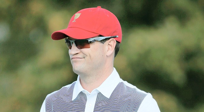 Team USA's Zach Johnson waits on the range during a practice round prior to the start of The Presidents Cup.